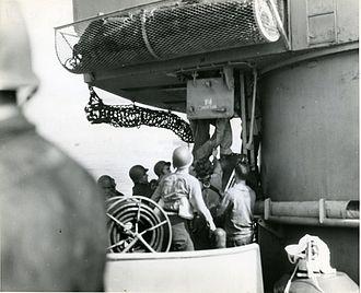 USS Savannah (CL-42) - Evacuating casualties from No. 3 turret