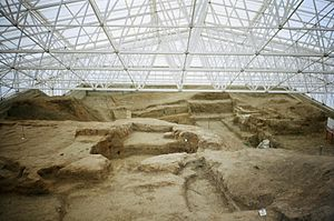 8th millennium BC - The south area of Çatalhöyük. An archaeological dig is in progress.