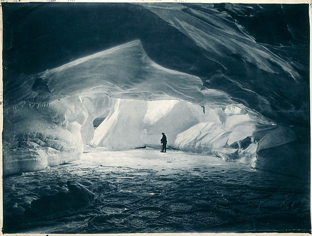 634px-Cavern_carved_by_the_sea_in_an_ice_wall_near_Commonwealth_Bay.jpg