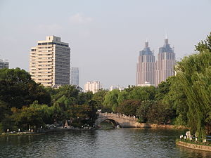 Changfeng Park - View of the boating lake in the park, with the two towers of the Global Harbor shopping mall in the distance.