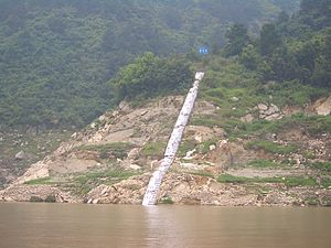 Three Gorges Reservoir Region - Water level in the reservoir (at the moment, 146 m above the sea level) measured by a shore marker. (Zigui County)