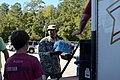 Chaplain 1st Lt. James Anderson with the South Carolina State Guard works alongside volunteers (22135900614).jpg