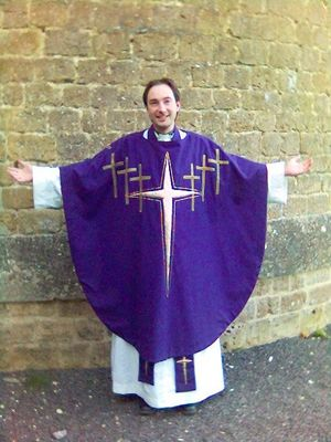 Chasuble - An Anglican priest wearing a modern chasuble over alb and stole.
