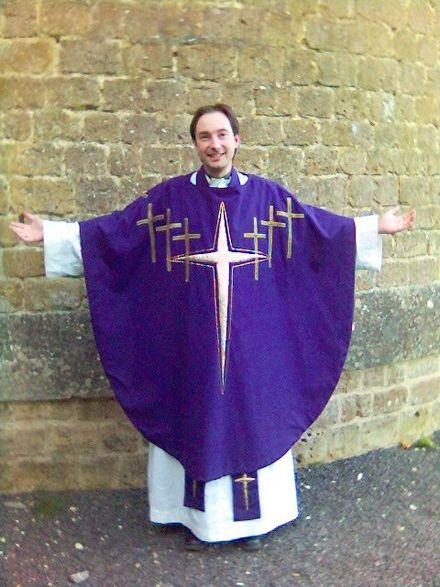 A priest in Eucharistic vestments. Chasublepurple.jpg