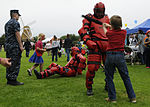 Children attack a U.S. Sailor in a redman suit provided by the Security Department of Naval Air Station Whidbey Island during Oak Harbor's National Night Out at Windjammer Park in Oak Harbor, Wash., Aug. 7 120807-N-BH078-155.jpg