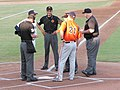 Coaches and umpires (3668771438).jpg