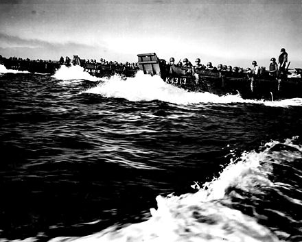 The first wave of troops approaching the beaches of Luzon. Coast Guard landing barges at Lingayen Gulf.jpg