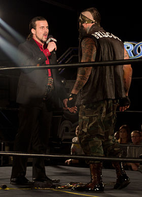 Cole confronts Jay Briscoe.jpg