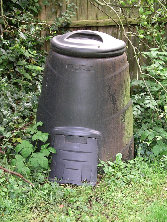 Photo of a compost bin with a door at the bott...