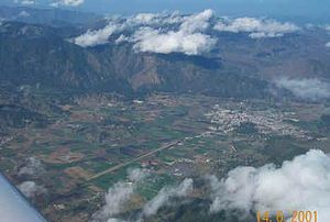 Cibao - Aerial view of Constanza, a town located in the Cibao region.