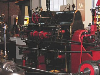 Corliss steam engine - Valve gear typical of engines developed by Corliss competitors. The horizontal arrangement of the dashpots and the lack of a wrist plate avoided key claims in the Corliss patents.