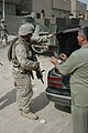 Corporal, a team leader, checks the contents of an Iraqi man's vehicle during a patrol.jpg