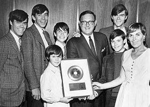 "The Cowsills - The group receives their gold record for ""The Rain, the Park and Other Things"" from MGM Records President Mort Nasatir, 1967."