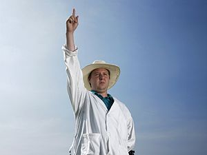 Umpire (cricket) - An umpire signalling the batsman as out