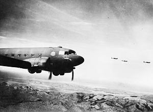 Battle of Wau - Dakotas fly across the mountains towards Wau. Blamey's ability to reinforce his position at Wau depended on these aircraft, but they were limited in numbers and hampered by the weather.
