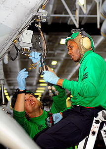 Defense.gov News Photo 110416-N-RG360-021 - Petty Officer 1st Class William Schuyler right and Petty Officer 1st Class Jason Siani both assigned to Anti-Submarine Helicopter Squadron 4.jpg