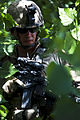 Defense.gov News Photo 110511-M-KO722-006 - U.S. Marine Corps Cpl. Garrett W. Bush with 1st Platoon Lima Company 3rd Battalion 4th Marine Regiment Regimental Combat Team 8 walks through.jpg