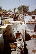 Delhi-slum-improvement-1983-white-washed-houses-electricity-poles-IHS-98-09.jpeg