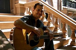Derek Reese brownstone stoop guitar.jpg