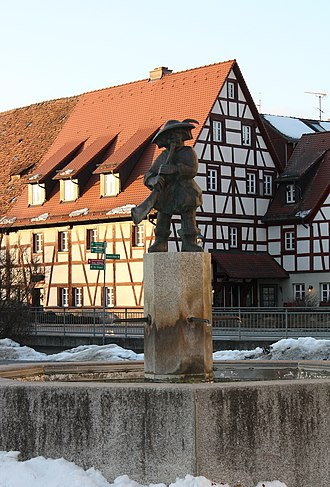 Dietenhofen - The Doodleman's Fountain with a half-timbered house in the background