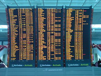 International airport - A flight information display system screen at Charles de Gaulle Airport's Terminal 2 showing flight arrivals