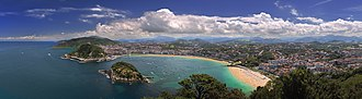 Louis Emmanuel Rey - This panoramic view shows San Sebastien from the west. Atop the headland at left center is the La Mota Castle, Rey's last place of refuge.