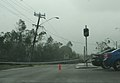 Downed power pole and lines on Hugh Street in Townsville.jpg