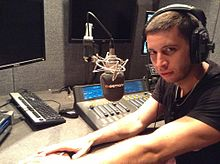 Elliot John Gleave during radio interview.jpg