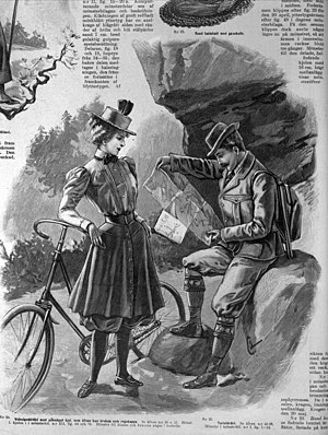 Bicycle touring - Woman in bicycle clothes and buttoned on skirt that also can be used as raincoat