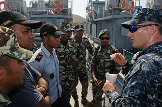 Timor Leste Defence Force - Members of the F-FDTL naval component with a US Navy sailor aboard Jaco