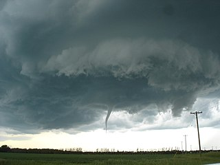 Funnel cloud funnel-shaped cloud of condensed water droplets, associated with a rotating column of wind