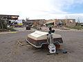 FEMA - 35413 - Small boat left upside down in a Colorado street after a tornado.jpg