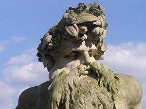 Ham House - A close-up image of the Father Thames statue in Coade stone at the front of the house