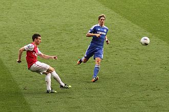 Laurent Koscielny - Koscielny and Fernando Torres in a Premier League match on 21 April 2012.