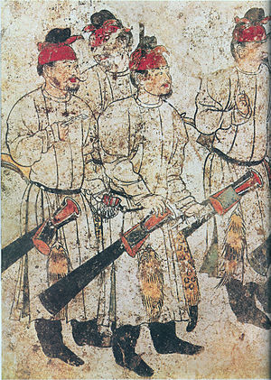 Qianling Mausoleum - Figures in a cortege, from a wall mural of Li Xian's tomb, dated 706 AD; each figure measures approximately 1.6 m (63 in) in height.