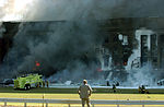 Firefighters work to put out the flames moments after a hijacked jetliner crashed into the Pentagon at approximately 0930 on September 11, 2001 010911-M-CI426-027.jpg