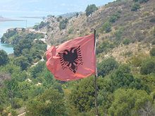 Flag of Albania Butrint.jpg