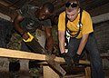 Flickr - Official U.S. Navy Imagery - US Sailor helps sailor from Sierra Leone during community service project..jpg