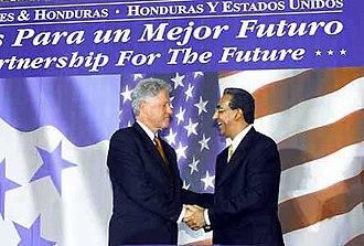 Phi Iota Alpha - Former President of Honduras, Carlos Flores with former President Bill Clinton
