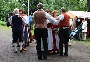 Folklore of Finland - Finnish folk dancers wearing folk costumes