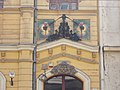 Former Metropolitan Shoemakers Guild headquarters. Monument ID 11573. Colorful mosaic images above street's door. - Budapest District VII. Wesselényi St 17.JPG