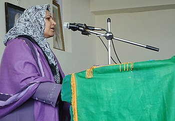 Former judge Rahila addresses the crowd at the...
