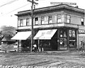 Fremont Pharmacy at southwest corner Fremont Ave and N 33rd St, Seattle, Washington, May 1, 1910 (LEE 109).jpeg