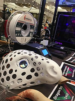 The 3D printed base for a fursuit mask, incorporating in tiny screens as eyes. Image: Nicholas Moreau.