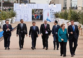 English: World leaders walk to the first worki...