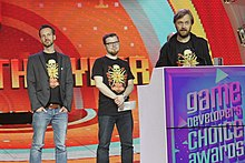 Three men onstage at Game of the Year awards