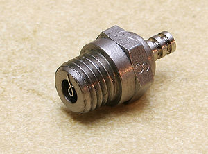 Glow plug (model engine) - Glowplug of a model aeroplane engine, where the end of the platinum-content helical ignition element can be seen.