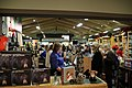 Great Smoky Mountains Association staff assists visitors in the bookstore at the 2018 Festival of Christmas Past, December 8, 2018--Warren Bielenberg (46269641274).jpg