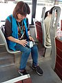 HK Tram 64 view 中環 Central staff woman at work 香港電車服務 問卷調查 訪問職員 using mobile device November 2019 SS2 01.jpg