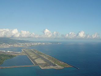 Daniel K. Inouye International Airport - The Reef Runway with Honolulu in the background
